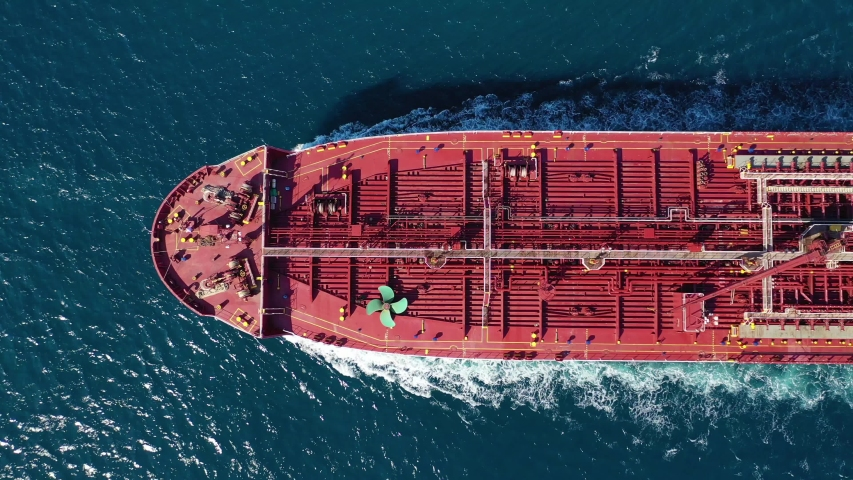 Aerial video of industrial oil and fuel tanker cruising open ocean sea | Shutterstock HD Video #1039932938