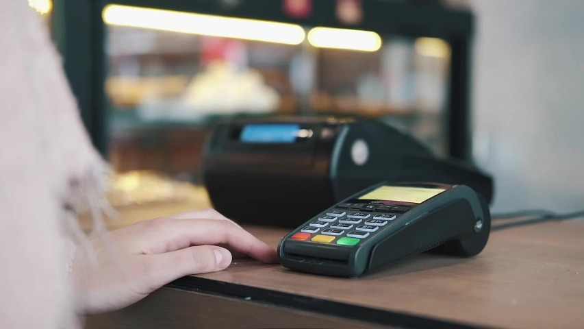 Concept contactless payment. Making payment with credit card and pos terminal, printed check. | Shutterstock HD Video #1040361938