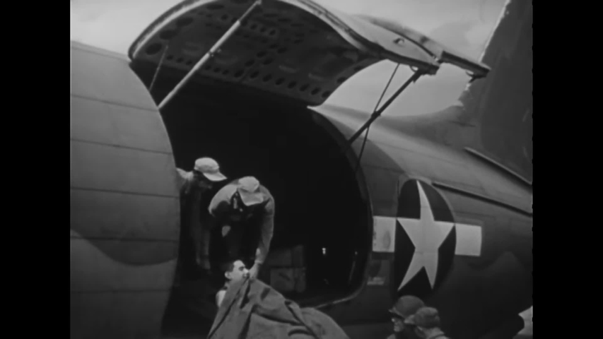 CIRCA 1945 - Wounded US Marines are transferred from ambulances to evacuation planes on Iwo Jima. | Shutterstock HD Video #1040490848