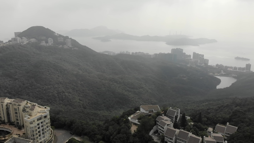 Aerial view from Victoria Peak to Lamma Island. Gray picture due to a lot of smog, poor visibility. Hong Kong   Shutterstock HD Video #1040818958