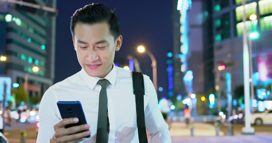 Businessman use 5g smart phone outdoor in the evening | Shutterstock HD Video #1040827658