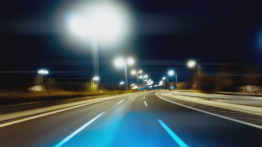 Driving hyperlapse pov on a bright futuristic highway night with endless twists, turns, and tunnels at high speeds. #1040851748