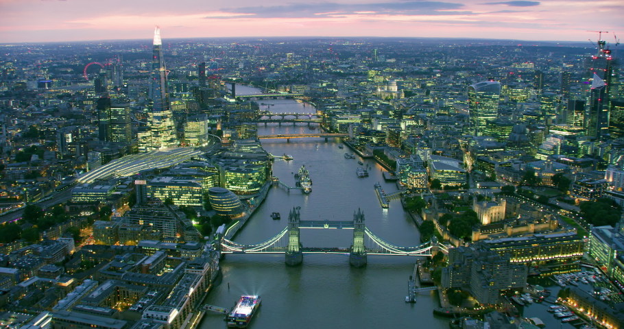 Aerial view of London's famous landmarks.The city financial district with its modern skyscrapers. Famous bridges and buildings. Thames River. England. UK. | Shutterstock HD Video #1040869238