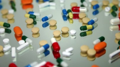 Pills rotate slowly in macro.