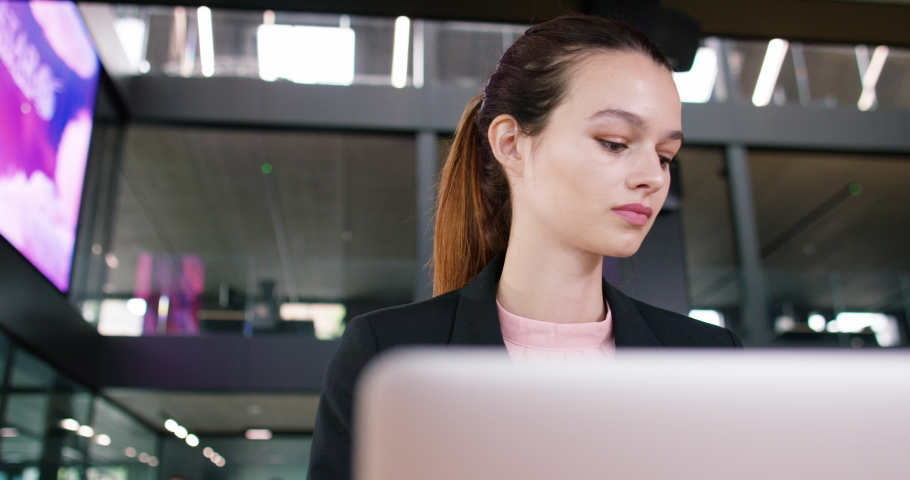 4K Young businesswoman working on laptop in modern office with electronic screen | Shutterstock HD Video #1041089698