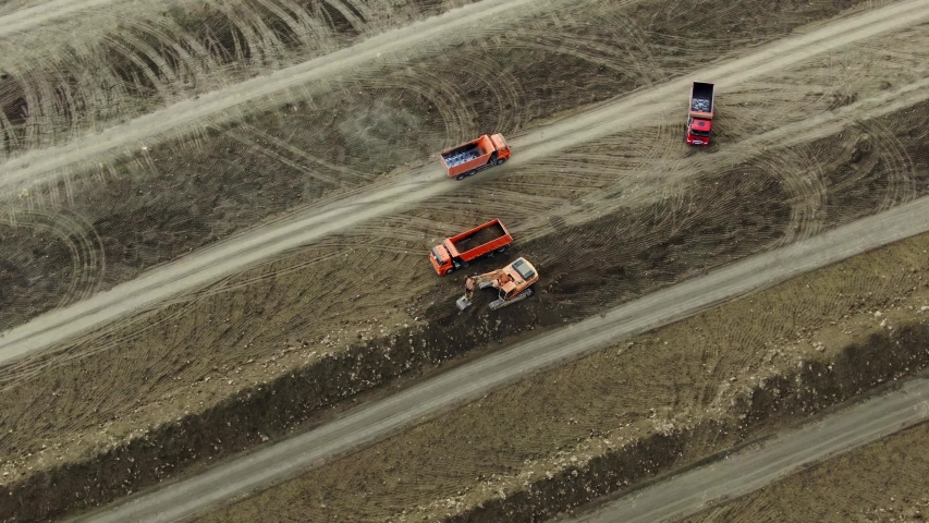 AERIAL MAY 2019 CRIMEA drone shooting excavator collects soil and puts it in the back of a truck | Shutterstock HD Video #1041100348