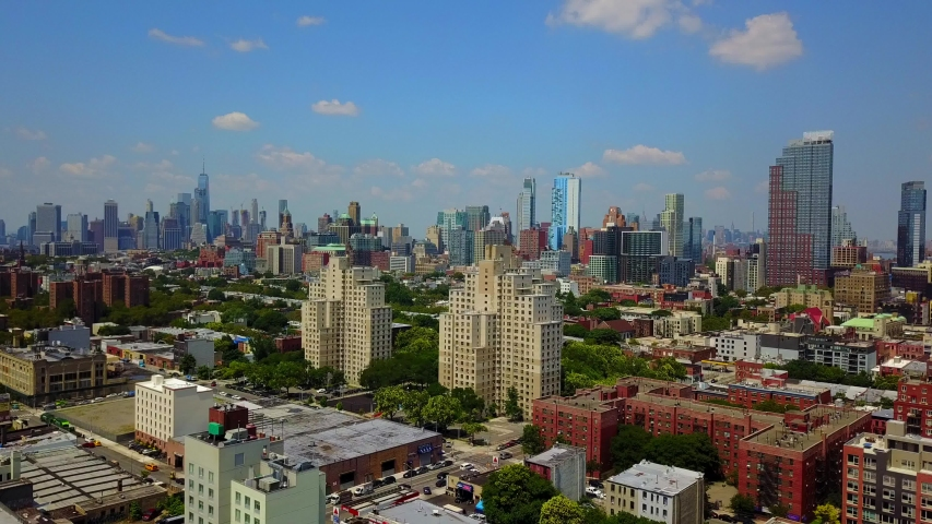 This video shows an aerial shot of Downtown Brooklyn skyline during the summer season.  | Shutterstock HD Video #1041416668