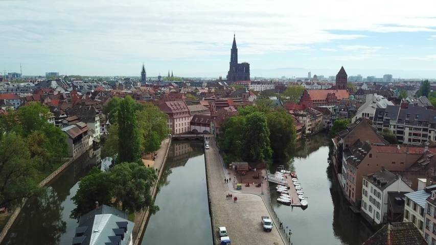 Aerial view of the river and the pier with ships. Cathedral of Notre Dame on the background. Strasbourg, France | Shutterstock HD Video #1041416938