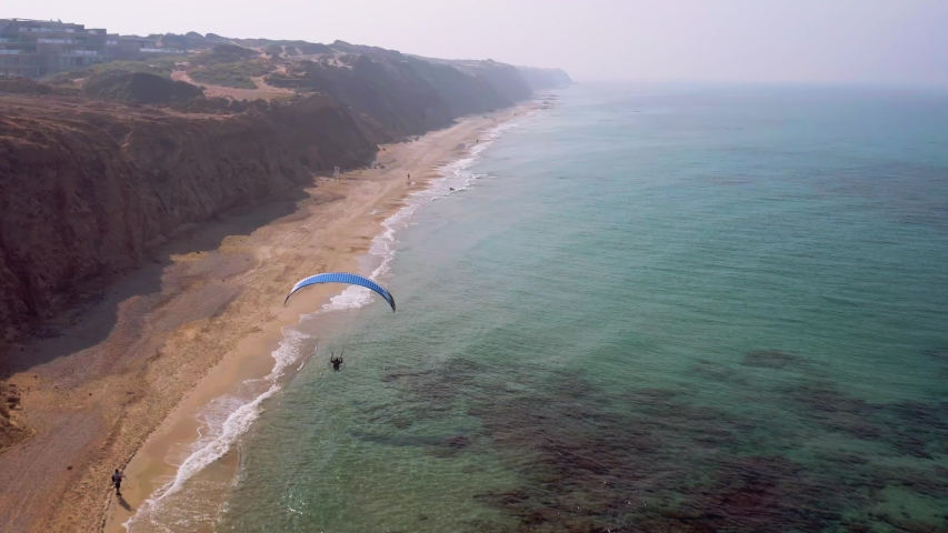 Paraplane parachute flying above a picturesque exotic beach, 4k aerial drone view | Shutterstock HD Video #1041465508