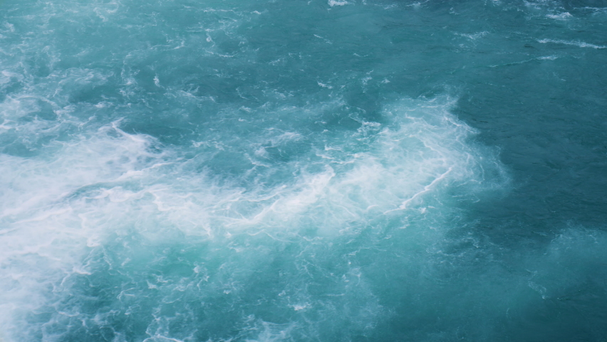 Water texture. Pure blue water with light reflections. Real time. | Shutterstock HD Video #1041482338
