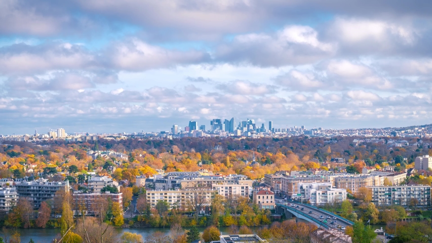 Zoom in to skyscrapers of Paris. Timelapse at a sunny autumn day with blue cloudy sky. | Shutterstock HD Video #1041697078