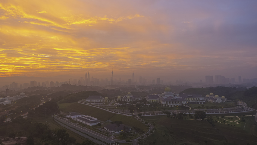 Cityscape Time lapse: Kuala Lumpur City Center view from afar during dawn overlooking the city skyline in Federal Territory, Malaysia. Zoom out motion timelapse. Prores 4K. | Shutterstock HD Video #1041908878