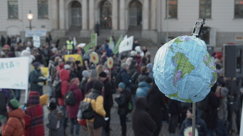 A blow-up globe being held at a climate protest. | Shutterstock HD Video #1041966448