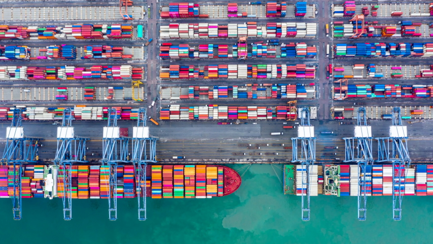 Aerial view time lapse container ship carrying container in import export business logistic and transportation of international by container ship in the open sea, Container ship at industrial port, 4K | Shutterstock HD Video #1041988438