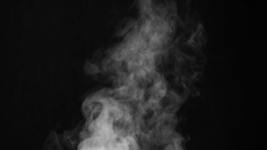 White Steam Ascends Over the Pan. White Steam rises from a large pot that is behind the scenes. Black background. Filmed at a speed of 120fps | Shutterstock HD Video #1042184308