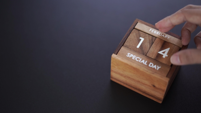 Day and month of special day of year fill into wooden cube calendar, copy space on left | Shutterstock HD Video #1042247938