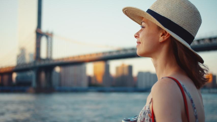 Smiling girl at Manhattan Bridge in New York City on vacation | Shutterstock HD Video #1042249198