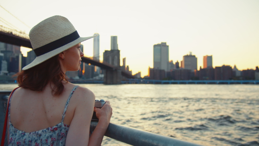 Young woman with a camera at the Brooklyn Bridge, NYC | Shutterstock HD Video #1042251808
