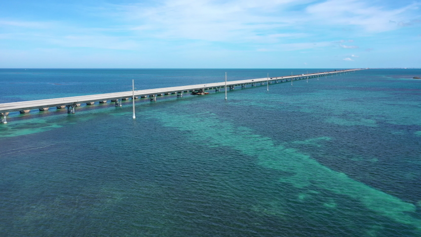 Aerial shot of the Seven Mile Bridge in Florida which connects several of the Florida Keys on the way to Key West | Shutterstock HD Video #1042489678