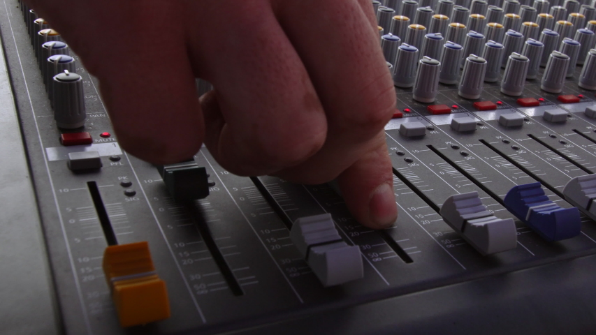 Audio sound mixer, hand moving slides and knobs, music equipment  | Shutterstock HD Video #1042539988