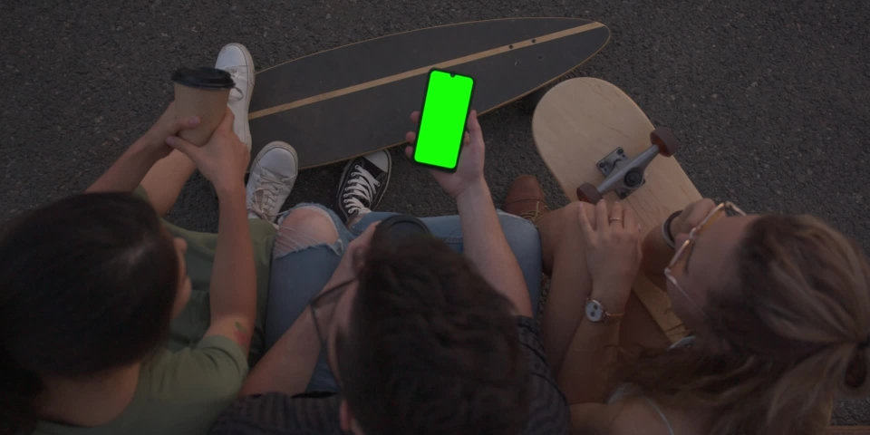 Green screen, CINEMATIC SHOT of friends hipsters millennials multinational girls young women and men sitting outside drinking coffee and chatting, talking. Slow motion   Shutterstock HD Video #1042562758