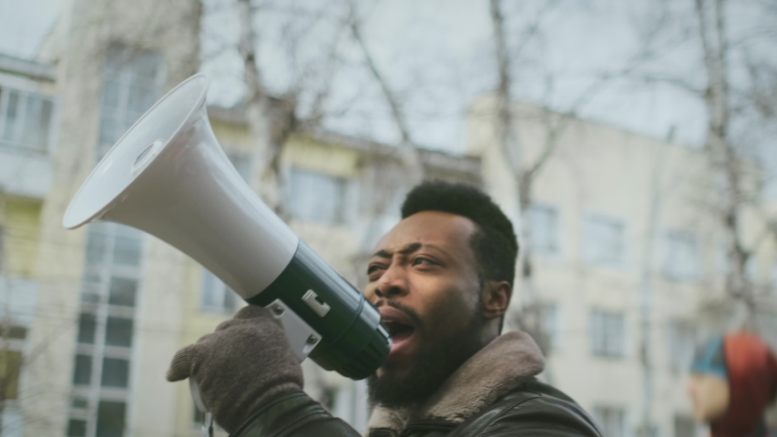 African american man hold megaphone in hand. Shouting out. Political rally. Social activists speack outdoor against. Resistance rebellion. Rebellious requirement activity. Many opposition public mass.
