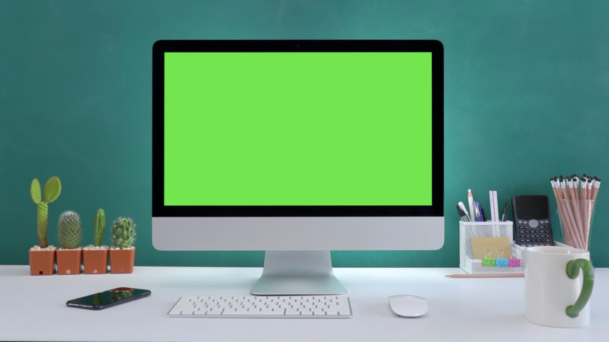 Computer desktop with mock-up green screen white background  in office and  Lovely cactus in brown pot , Zoom shoulder view. | Shutterstock HD Video #1042591438