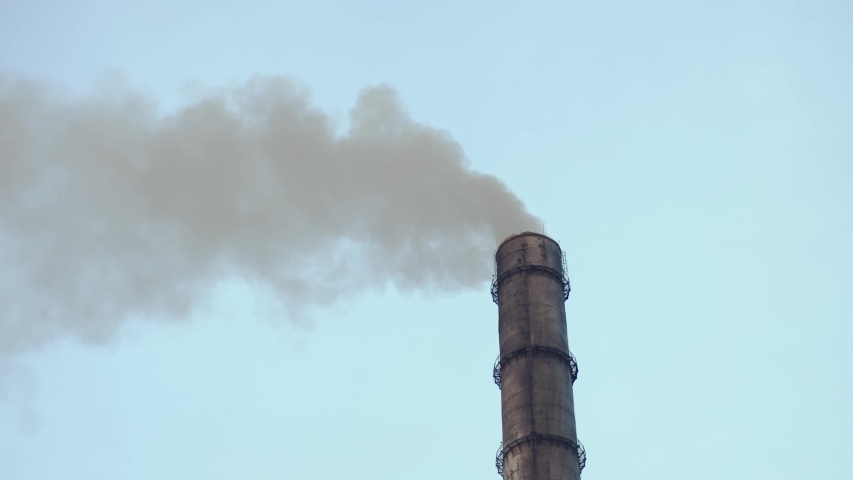 Large red and white pipe thick white smoke coming out from the factory pipe in contrast to blue sky and nature. Air Pollution of environment. Climate crisis. Dirty emissions. Industrial business. | Shutterstock HD Video #1042593448