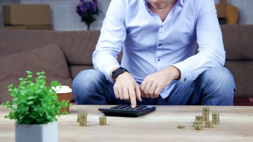 Worried man counting money on table, price inflation, low-paid job, savings   Shutterstock HD Video #1042599478