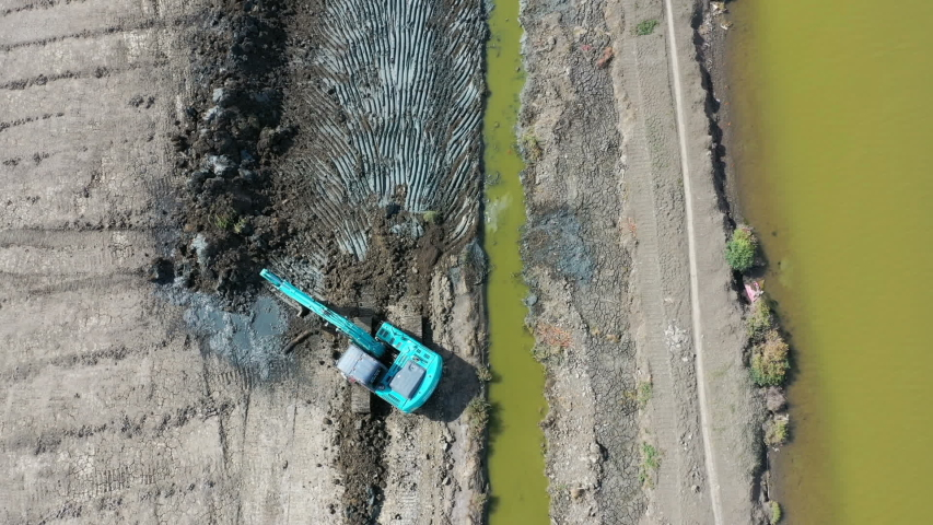 Aerial view machinery Backhoe Working outdoor | Shutterstock HD Video #1042750408