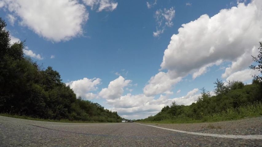 Timelapse gopro view from car driving along the asphalt road in summer | Shutterstock HD Video #1042818118