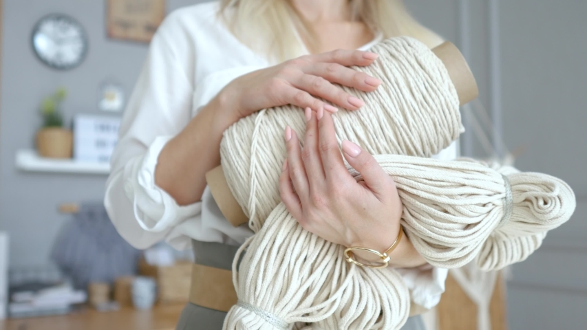 Close-up stylish woman holds a coil of light thread of ropes | Shutterstock HD Video #1042885258
