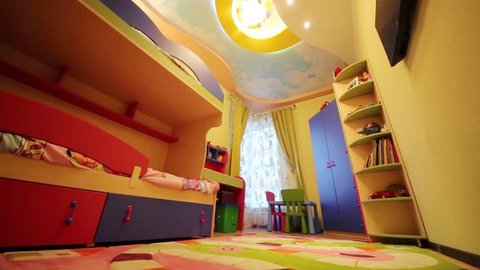 Under view of kids room with bunk bed and soft carpet