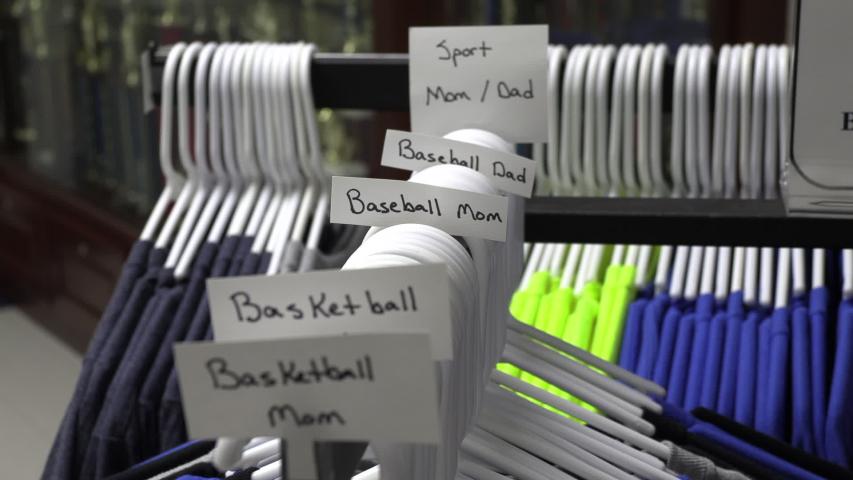 A sale rack of high school spirit wear | Shutterstock HD Video #1044780328