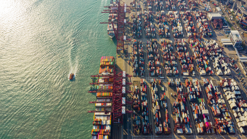 Hyperlapse or Dronelapse Top view of international port with Crane loading containers in import export business logistics.   Shutterstock HD Video #1044848158