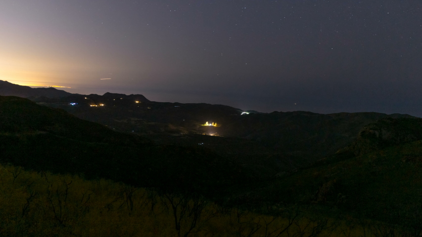 Astro timelapse of stars over Pacific Ocean at hilltop in Malibu, California   Shutterstock HD Video #1044861148