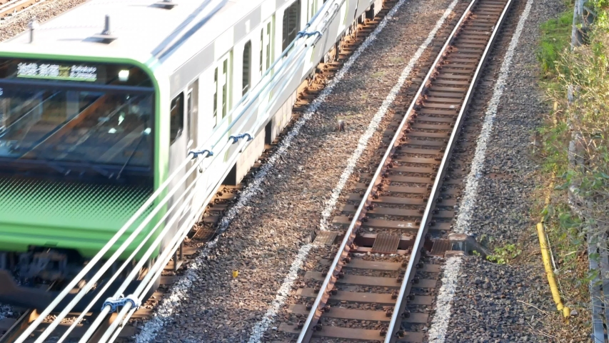 POV from above railway while train is running pass surrounding with local landscape in suburban of Tokyo,Japan. Tokyo,Big CITY metropilitant transportation. | Shutterstock HD Video #1044928138