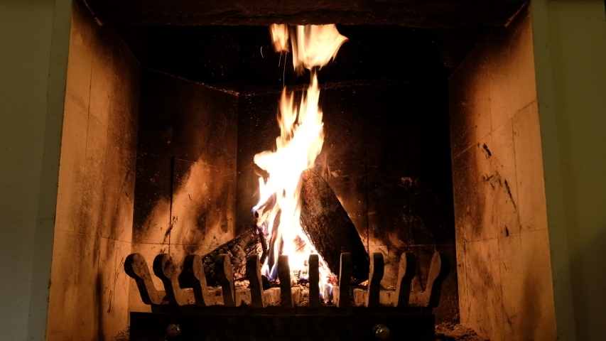 Warm fireplace view in winter at home      | Shutterstock HD Video #1044935398