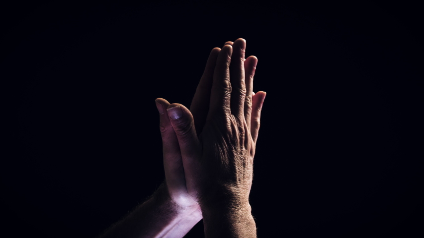 Male hands in close-up coming together and praying. | Shutterstock HD Video #1045011868