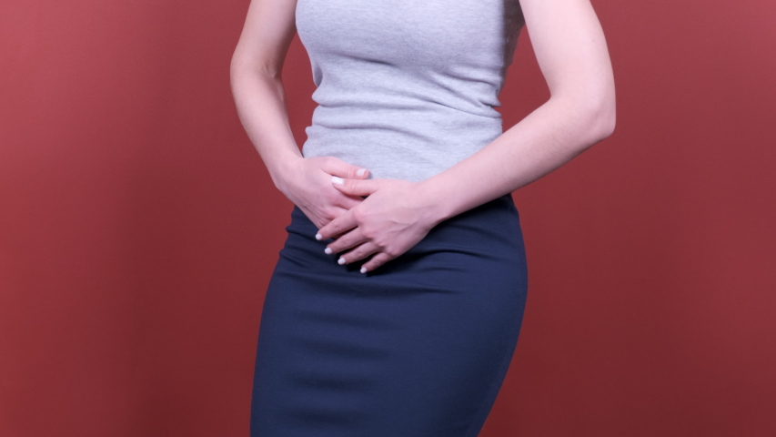 Stomach ache. Woman holds hands stomach. Menstrual pain or bowel problems. Pain. | Shutterstock HD Video #1045022788