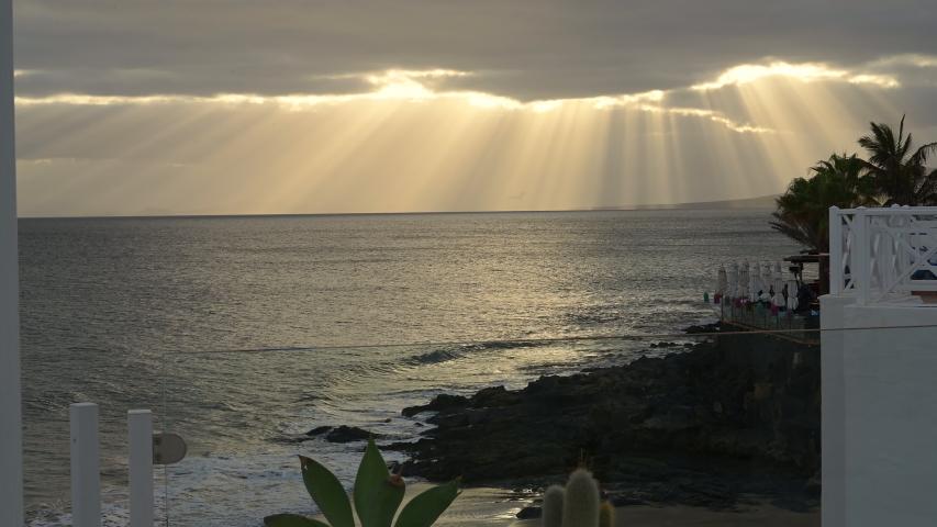 Setting sun over a holiday beach | Shutterstock HD Video #1045033528