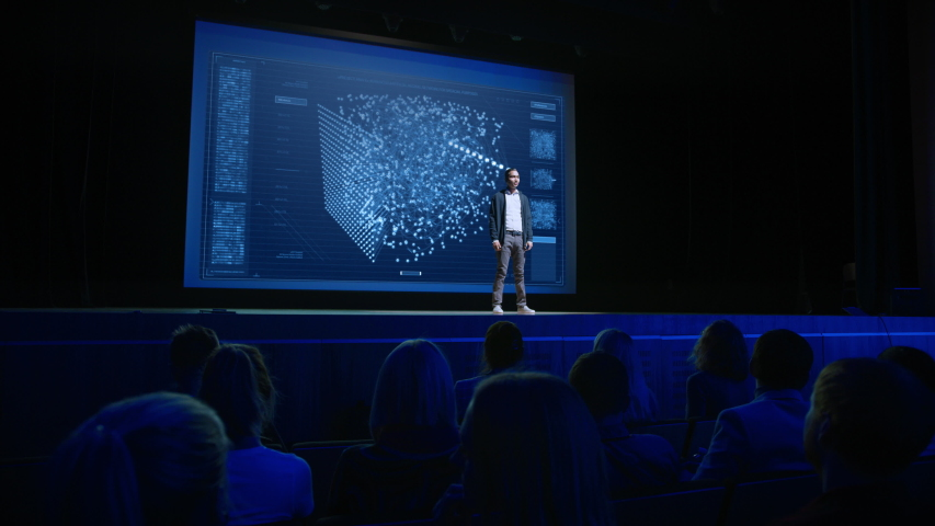 Computer Science Startup Conference: On Stage Speaker Presents New Product, Talks about Neural Networks, Shows Artificial Intelligence App on Big Screen.  | Shutterstock HD Video #1045096468