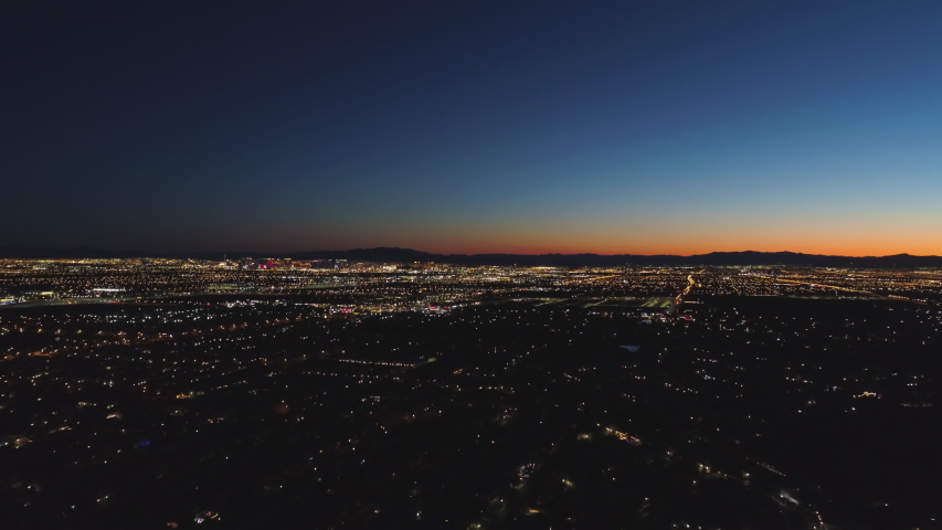 Las Vegas City at Sunrise. Morning Twilight. Mountains on Background. Nevada, USA. Aerial View. Drone Flies Forward, Tilt Up. Reveal Shot | Shutterstock HD Video #1045248418