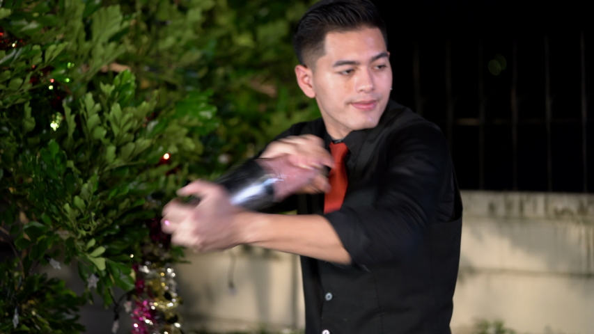 Asian barman is making cocktail at birthday night party. Handheld shot and Real life, Night party concept | Shutterstock HD Video #1045340308