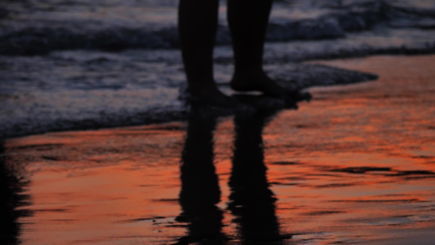 Feet get out from water of footsteps Silhouette | Shutterstock HD Video #1045365928