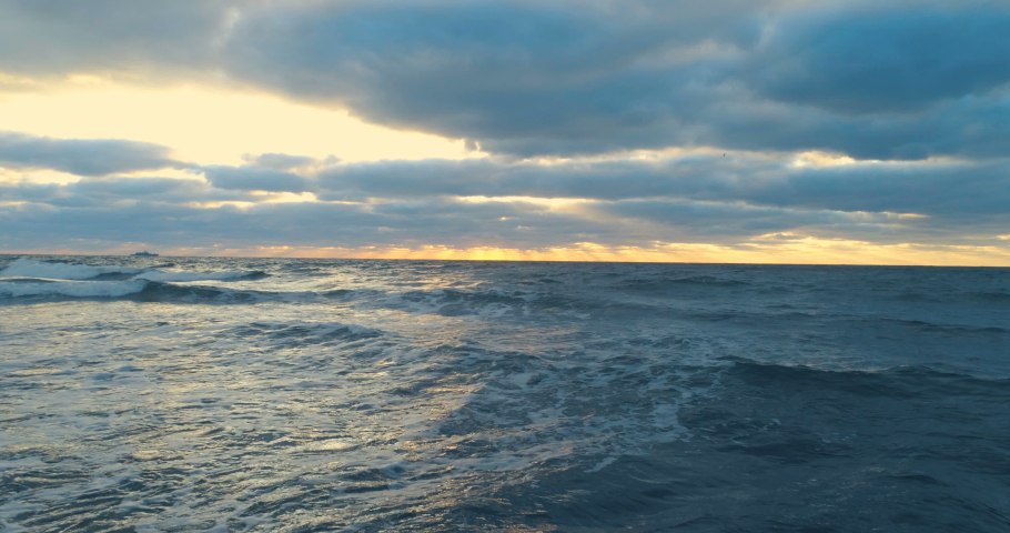 Aerial top view of peaceful calm dark blue sea water surface, cloudy sunset or sunrise sky. 4k drone video footage. | Shutterstock HD Video #1045449988