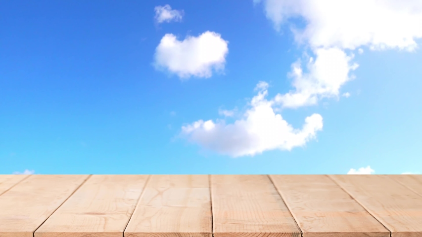 Wooden table or mock up platform  over cloudy blue sky | Shutterstock HD Video #1045451248