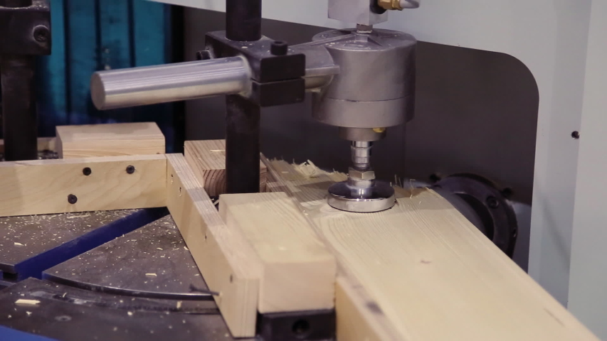 Cnc milling machine cuts a groove from a wooden block. | Shutterstock HD Video #1045462798