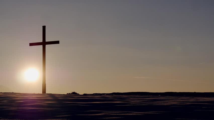 Cross on a hill during sunset / timelapse / streak on the sky #10460468