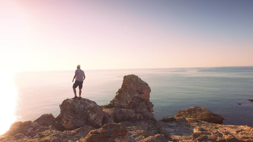 Aerial Of Young Handsome Businessman Silhouette Walking Standing On Ocean Cliff Edge Sea Vacation Happiness Concept #10461812